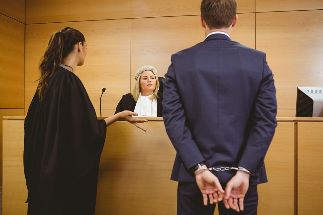 judge-talking-with-the-criminal-in-handcuffs-in-the-court-room