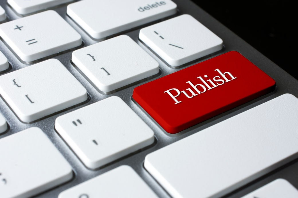 publish-on-red-enter-button-on-white-keyboard